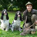 Hubert a Niké s uloveným jelenem